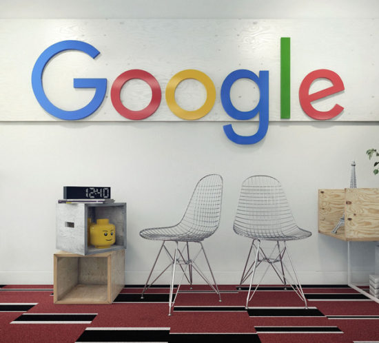 Two metal chairs and wooden boxes in front of the white wall with company logo