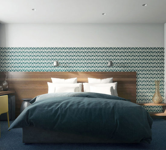 Double bed with natural wood header and patern wallpaper