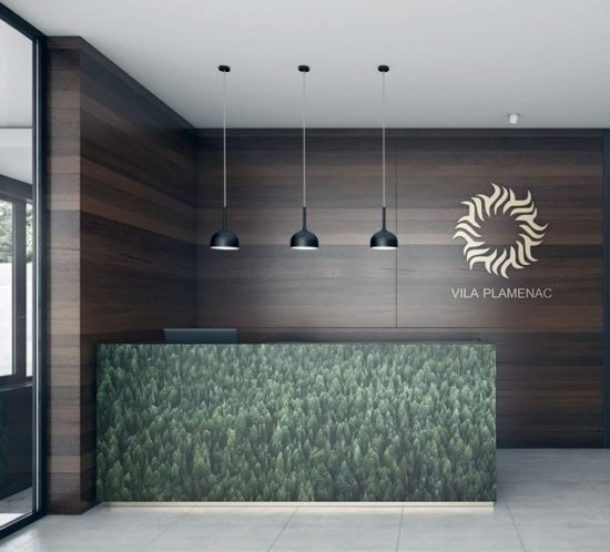 Reception area with wallpaper desk and natural wood
