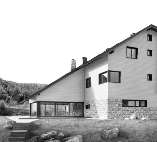 Side view of modern mountain social center with wooden facade